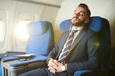 sleeping business man on plane